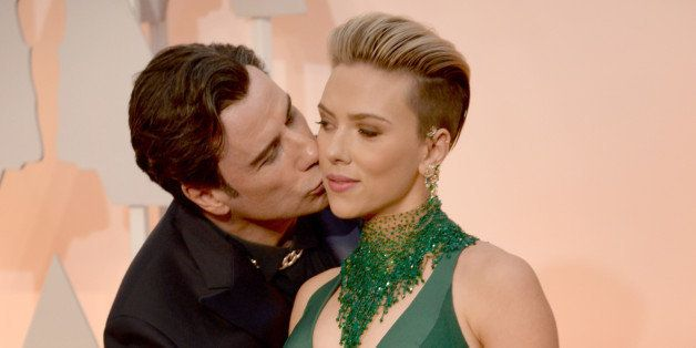 HOLLYWOOD, CA - FEBRUARY 22:  Actor John Travolta (L) and actress Scarlett Johansson attend the 87th Annual Academy Awards at
