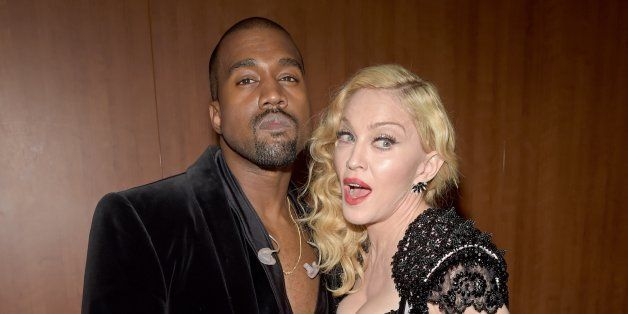LOS ANGELES, CA - FEBRUARY 08:  Recording artist Kanye West (R) and singer Madonna (L) attend The 57th Annual GRAMMY Awards a