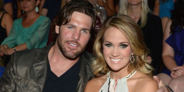 NASHVILLE, TN - JUNE 04:  Mike Fisher (L) and Carrie Underwood attend the 2014 CMT Music awards at the Bridgestone Arena on J