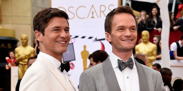 HOLLYWOOD, CA - FEBRUARY 22:  Host Neil Patrick Harris (R) and actor David Burtka attend the 87th Annual Academy Awards at Ho