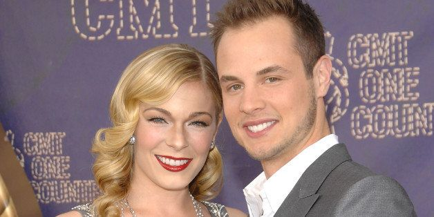 FILE - In this April 14, 2008 file photo,sSinger LeAnn Rimes and her husband Dean Sheremet arrive at the 2008 CMT Awards in N