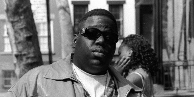 American rapper Biggie Smalls (also known as the Notorious B.I.G., born Christopher Wallace, 1972 - 1997) holds a bottle of S