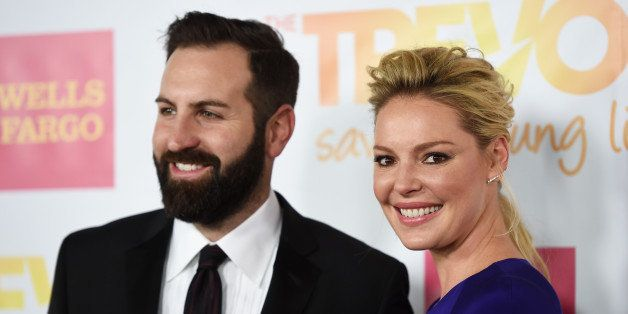 LOS ANGELES, CA - DECEMBER 07:  Actress Katherine Heigl (R) and her husband, musician Josh Kelley arrive at the TrevorLIVE Lo