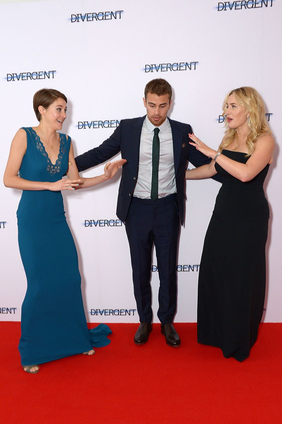 Shailene Woodley, Theo James and Kate Winslet pose for photographers at the European film premiere of Divergent in Leicester