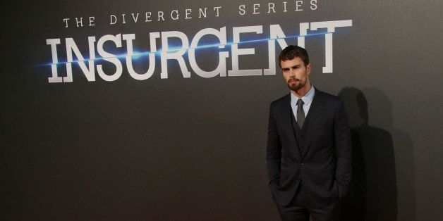 Actor Theo James poses for photographers upon arrival at a central London cinema for the World Premiere of Insurgent, Wednesd