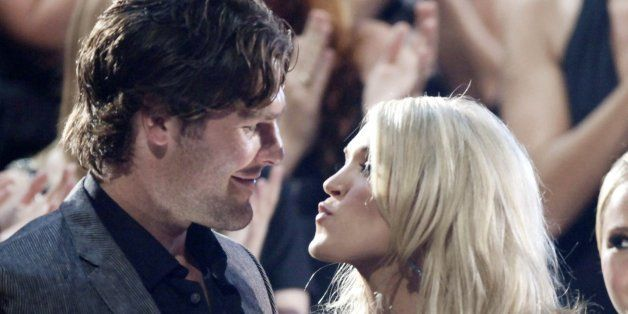 """Carrie Underwood kisses her boyfriend Mike Fisher of the NHL Ottawa Senators as she won """"Video of the Year"""" at the 2010 CMT A"""