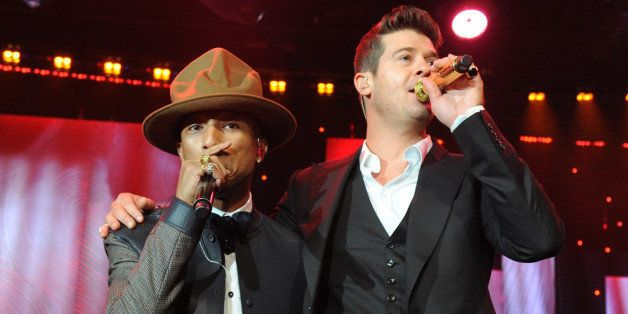 LOS ANGELES, CA - JANUARY 25:  Pharrell Williams and Robin Thicke perform onstage during the 56th annual GRAMMY Awards  Pre-G