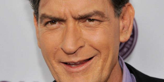 """Charlie Sheen, a cast member in """"Scary Movie V,"""" poses at the Los Angeles premiere of the film at the Cinerama Dome on Thursd"""