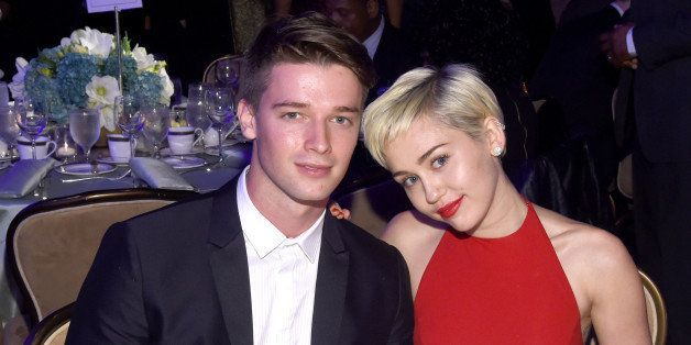 LOS ANGELES, CA - FEBRUARY 07:  Recording artist Miley Cyrus (R) and Patrick Schwarzenegger attend the Pre-GRAMMY Gala and Sa