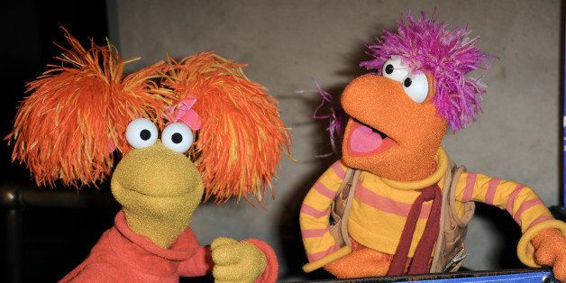 Red Fraggle, left, and  Gobo Fraggle arrive at Jim Henson's Fraggle Rock 30th Anniversary at Hollywood Roosevelt Hotel on Wed