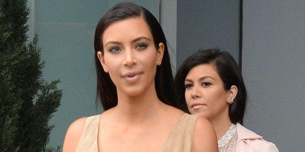NEW YORK, NY - JUNE 26:  Kim Kardashian and Kourtney Kardashian are seen is seen in Soho on June 26, 2014 in New York City.