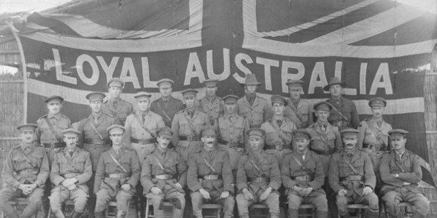 Group portrait of officers of the 3rd Battalion in front of a large Union Jack flag bearing the words 'Loyal Australia' acros