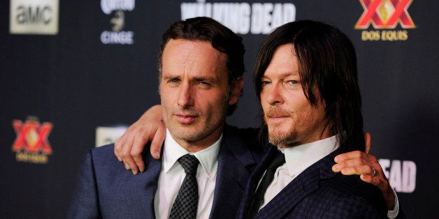 "Andrew Lincoln, left, and Norman Reedus, cast members in the television series ""The Walking Dead,"" pose together at a special"