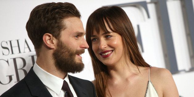 Jamie Dornan and Dakota Johnson pose for photographers upon arrival at the UK premiere of the film 'Fifty Shades of Grey' in
