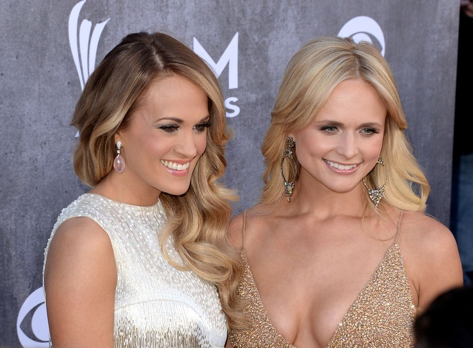 LAS VEGAS, NV - APRIL 06:  Singer/songwriter Carrie Underwood (L) and musician Miranda Lambert attend the 49th Annual Academy