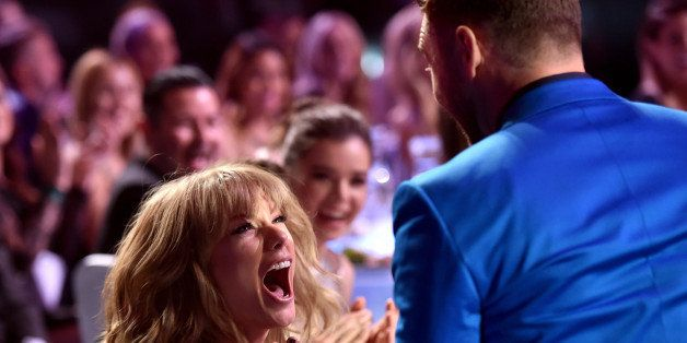 LOS ANGELES, CA - MARCH 29:  Singer/songwriter Taylor Swift (L) reacts to winning the Best Lyrics award for 'Blank Space' wit