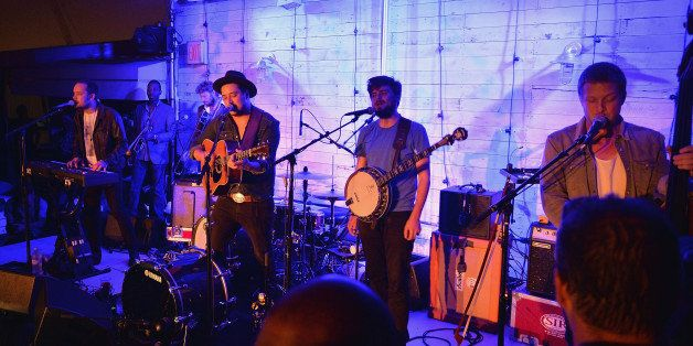 NEW YORK, NY - AUGUST 22: Mumford & Sons perform live at Soho House New York's 10th Birthday Celebration on August 22, 2013 in New York City. (Photo by Andrew H. Walker/Getty Images for Soho House)