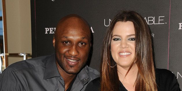 ORANGE, CA - JUNE 07:  Lamar Odom and Khloe Kardashian make a personal appearance for 'Unbreakable Bond' at Perfumania on Jun