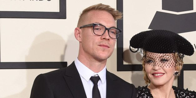 LOS ANGELES, CA - FEBRUARY 08:  (L-R) Producer Diplo, singer Madonna, and rapper Nas attend The 57th Annual GRAMMY Awards at