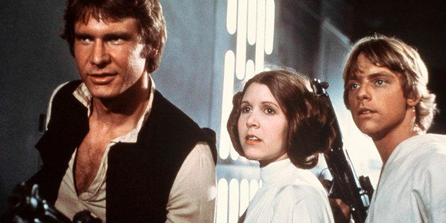 FILE - This file publicity image provided by 20th Century-Fox Film Corporation shows Harrison Ford, as Han Solo, Carrie Fishe