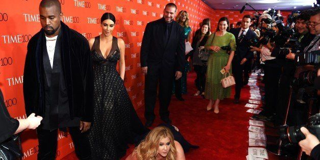 Honoree and Comedian Amy Schumer pretends to trip and fall on the floor  in front of honorees Kim Kardashian (2nd-L) and Kany