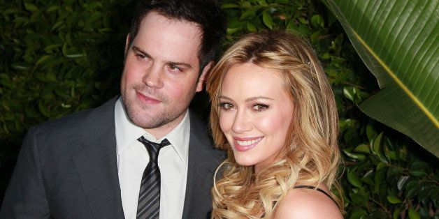 BEVERLY HILLS, CA - MAY 11:  Professional hockey player Mike Comrie (L) and wife actress Hilary Duff attend An Evening of 'So