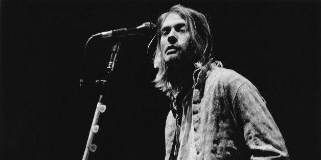 Singer-songwriter and guitarist Kurt Cobain (1967 - 1994) performing with American grunge band Nirvana at Palasport, Modena,