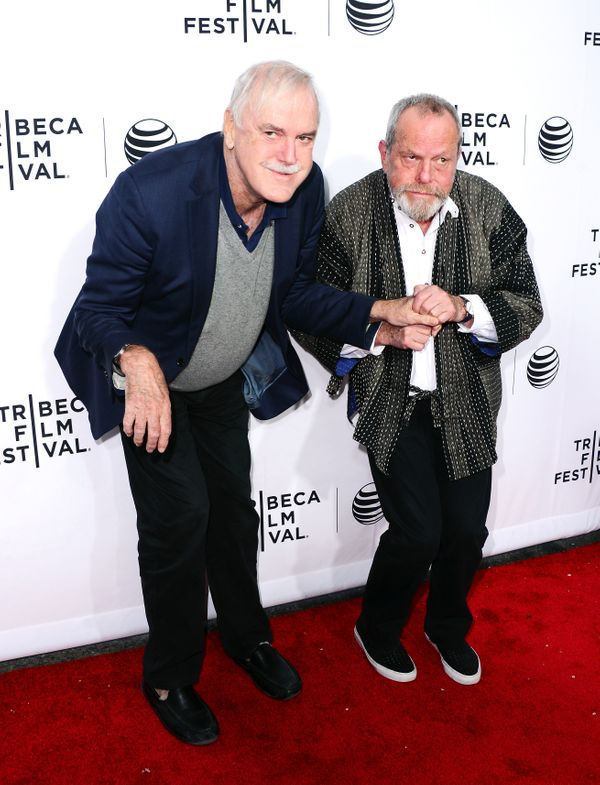 John Cleese and Terry Gilliam goofing around on the red carpet.