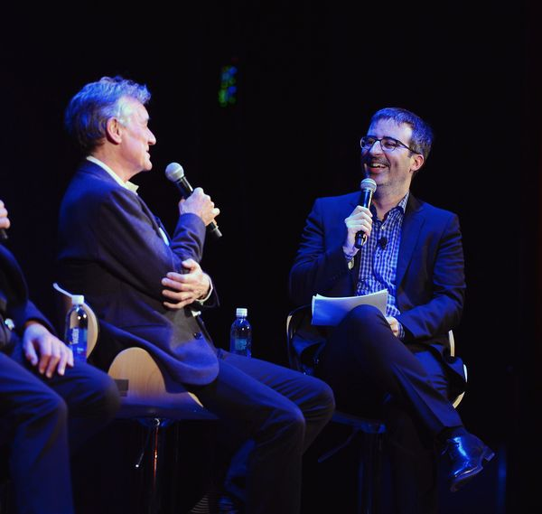 Michael Palin and moderator John Oliver speak at the panel discussion.