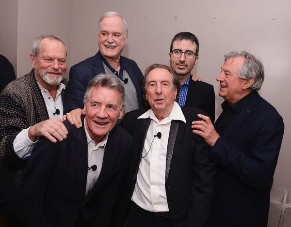 Terry Gilliam, Michael Palin, John Cleese, Eric Idle, John Oliver and Terry Jones pose for a photo backstage.