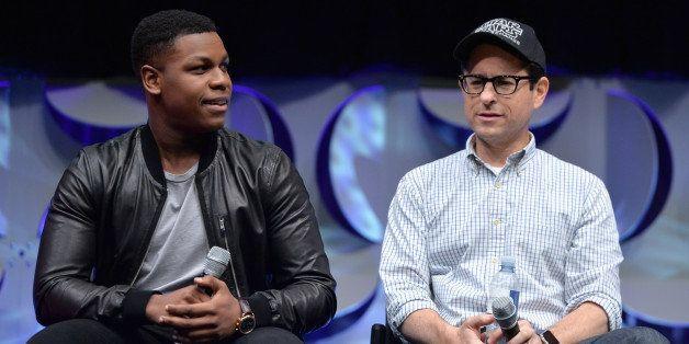ANAHEIM, CA - APRIL 16: Actor John Boyega (L) and Director J.J. Abrams speak onstage during Star Wars Celebration 2015 on Apr