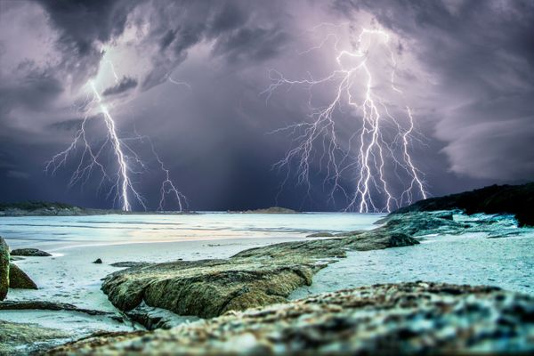 A thrill-seeking storm chaser captured the precise moment these giant lightning bolts lit up dark skies in a series of incred