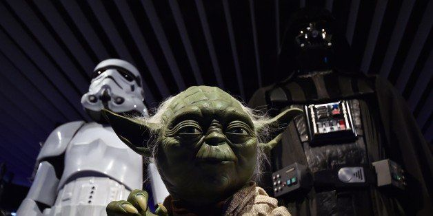 A statue of Yoda is displayed at the preview of the 'Star Wars Vision' exhibition in Tokyo on April 28, 2015. Star Wars-relat