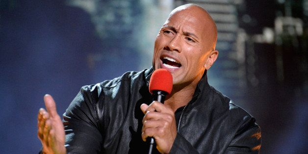 LOS ANGELES, CA - APRIL 12:  Actor Dwayne Johnson speaks onstage during The 2015 MTV Movie Awards at Nokia Theatre L.A. Live