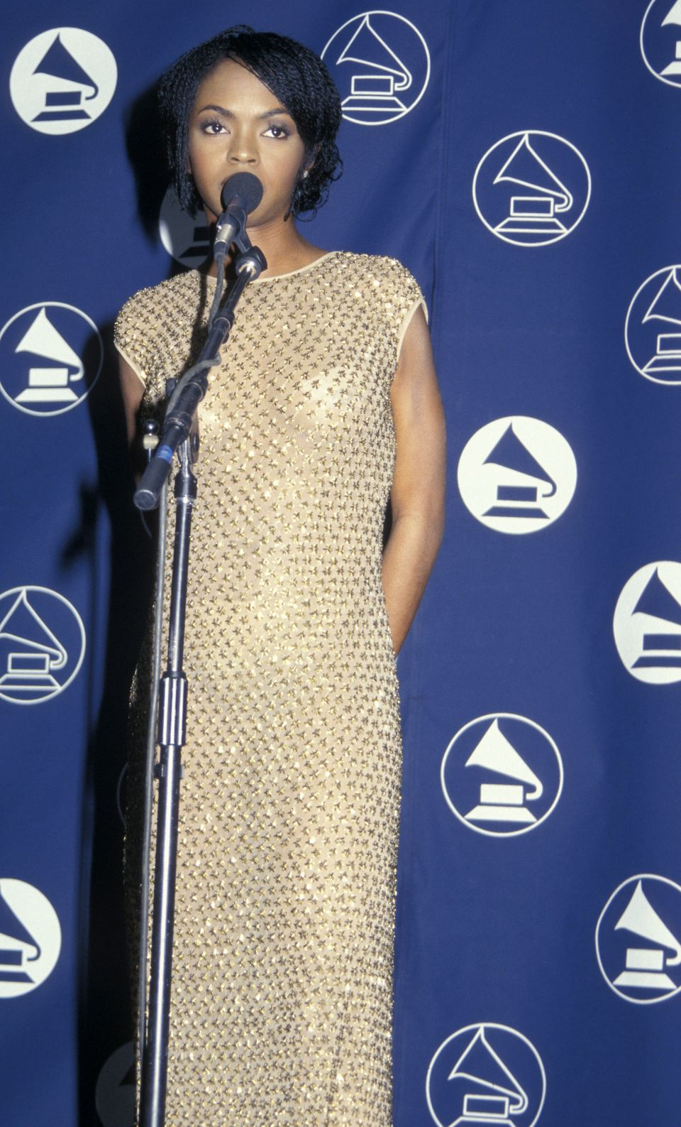 Lauryn looks like a vintage goddess in this gold beaded frock.