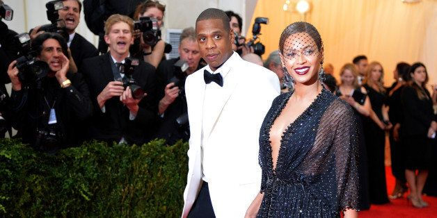 NEW YORK, NY - MAY 05:  Jay-Z (L) and Beyonce attend the 'Charles James: Beyond Fashion' Costume Institute Gala at the Metrop