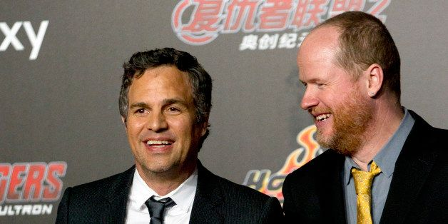 Actor Mark Ruffalo, left, and director Joss Whedon, right, pose for photos at a red carpet event for their latest film, Marve