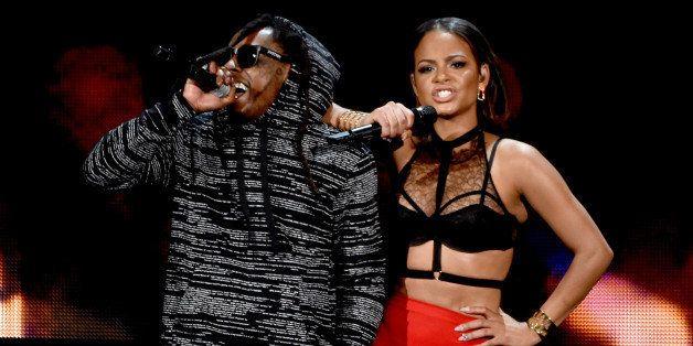 LOS ANGELES, CA - NOVEMBER 23:  Recording artist/actress Christina Milian (L) and recording artist Lil Wayne perform onstage