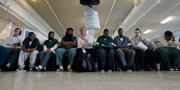 In this photo taken Aug. 2, 2011, former New Jersey Gov. James McGreevey, center, speaks to a gathering of women inmates at I
