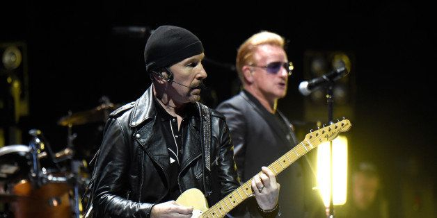 VANCOUVER, BC - MAY 14:  Musicians The Edge  (L) and Bono of U2 perform onstage during the U2 iNNOCENCE + eXPERIENCE tour ope