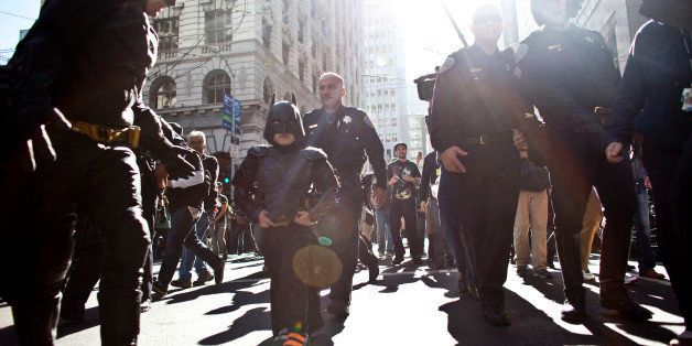 SAN FRANCISCO, CA - NOVEMBER 15: Police escorts leukemia survivor Miles, 5, dressed as BatKid, and Batman after they arrest t
