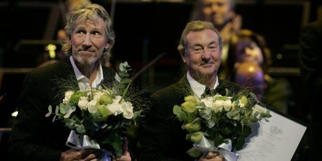 Roger Waters, left, and Nick Mason, right, of the British group Pink Floyd, receive the Polar Music Prize from His Majesty Ki