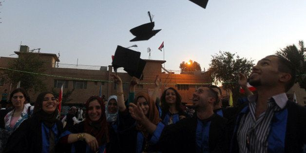 Iraqi students throw their hats duriing their graduation ceremony at Technical University of Baghdad on June 30, 2012 to cele