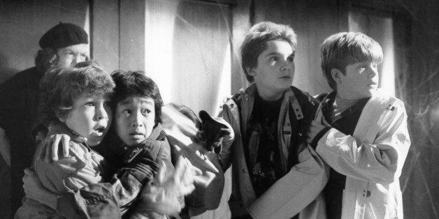 From left to right, Anne Ramsey, Jeff Cohen, Jonathan Ke Quan, Corey Feldman and Sean Astin with frightened expressions in a