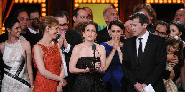 """Kristin Caskey, center, along with cast and crew accepts the award for best musical for """"Fun Home""""at the 69th annual Tony"""