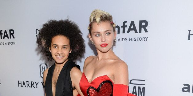 Honoree Miley Cyrus, right, arrives with friend Tyler Ford at the 6th Annual amfAR New York Inspiration Gala at Spring Studio