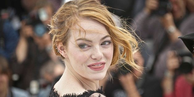 Emma Stone poses for photographers during a photo call for the film Irrational Man, at the 68th international film festival,
