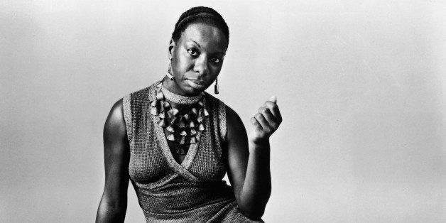 UNSPECIFIED - 1968: This studio portrait shows American pianist and jazz singer Nina Simone reclining on the floor circa 1968