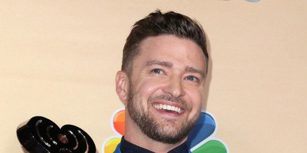 Justin Timberlake poses in the press room with the iHeartRadio Innovator award at the iHeartRadio Music Awards at The Shrine