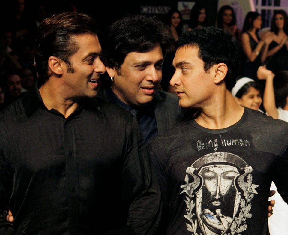 In this photo taken Tuesday, Oct. 13, 2009, Bollywood actors Salman Khan, left, Govinda, center, and Aamir Khan walk the runw